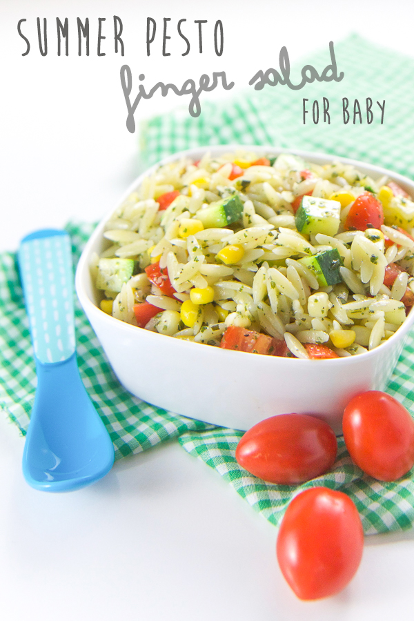 This Pesto Summer Finger Salad for Baby + Toddler is full of bite-size pieces of corn, tomatoes, zucchini and orzo pasta all mixed together with a spoonful of flavorful pesto. This finger salad is a great way for baby to enjoy the delicious tastes of summer. #healthy #recipes #realfood #healthykids #summer #pesto #toddler #pasta