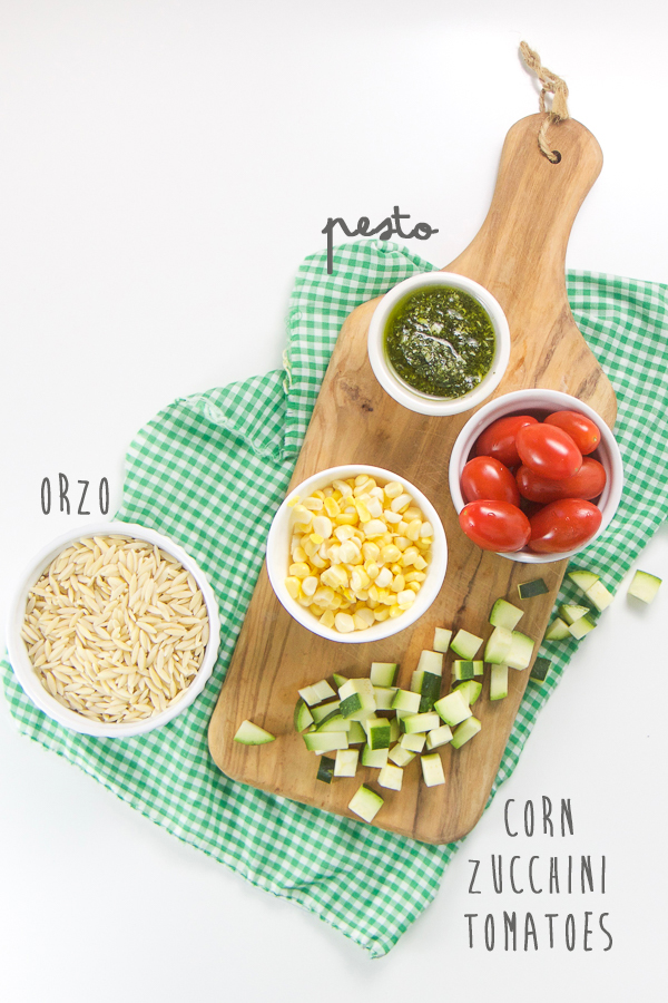 This Pesto Summer Finger Salad for Baby + Toddler is full of bite-size pieces of corn, tomatoes, zucchini and orzo pasta all mixed together with a spoonful of flavorful pesto. This finger salad is a great way for baby to enjoy the delicious tastes of summer.