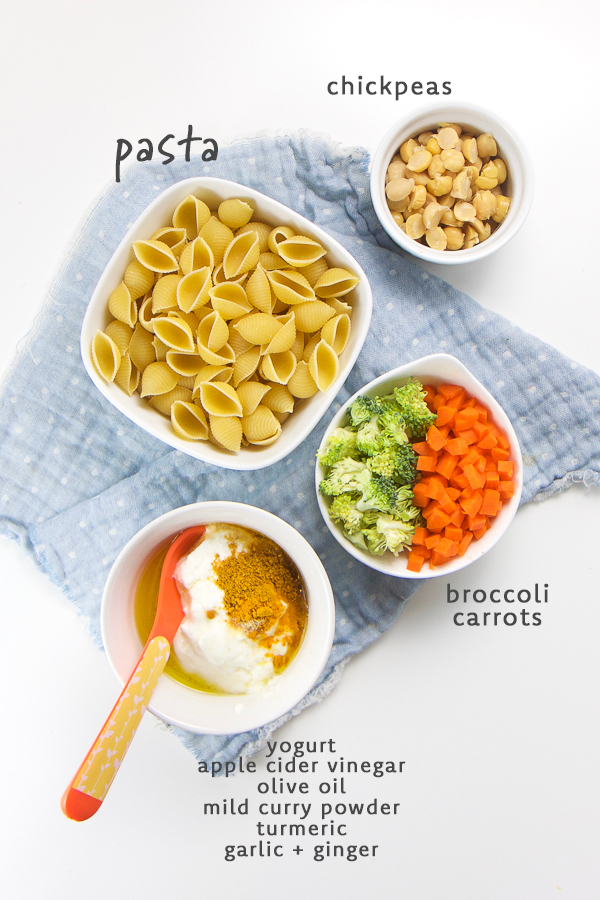 Bite sized pasta, broccoli, carrots and chickpeas get tossed in a tasty mild curry sauce that will delight any baby or toddler's growing taste buds! This finger food salad is a fun way to introduce curry to baby. Perfect for baby led weaning and the finger food stage! #pasta #fingerfood #babyledweaning #toddlers #healthykids
