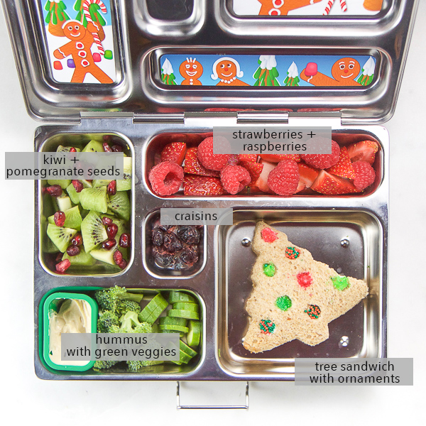 Send a little holiday cheer to your kids and toddlers at school or daycare with this Christmas School Lunch! This festive packed school lunch is nut free, dairy free, gluten free, super healthy and delicious, but packed with holiday fun! #schoollunch #christmas