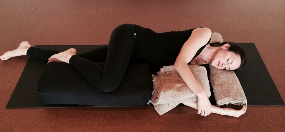 Side-lying Savasana, a good modification during pregnancy.