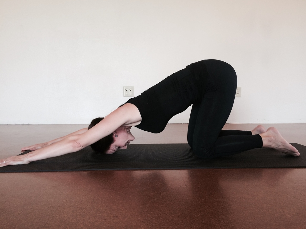 Puppy pose provides many of the same benefits as Downward facing dog, with less weight on the wrists and less stretch to the hamstring and calves.