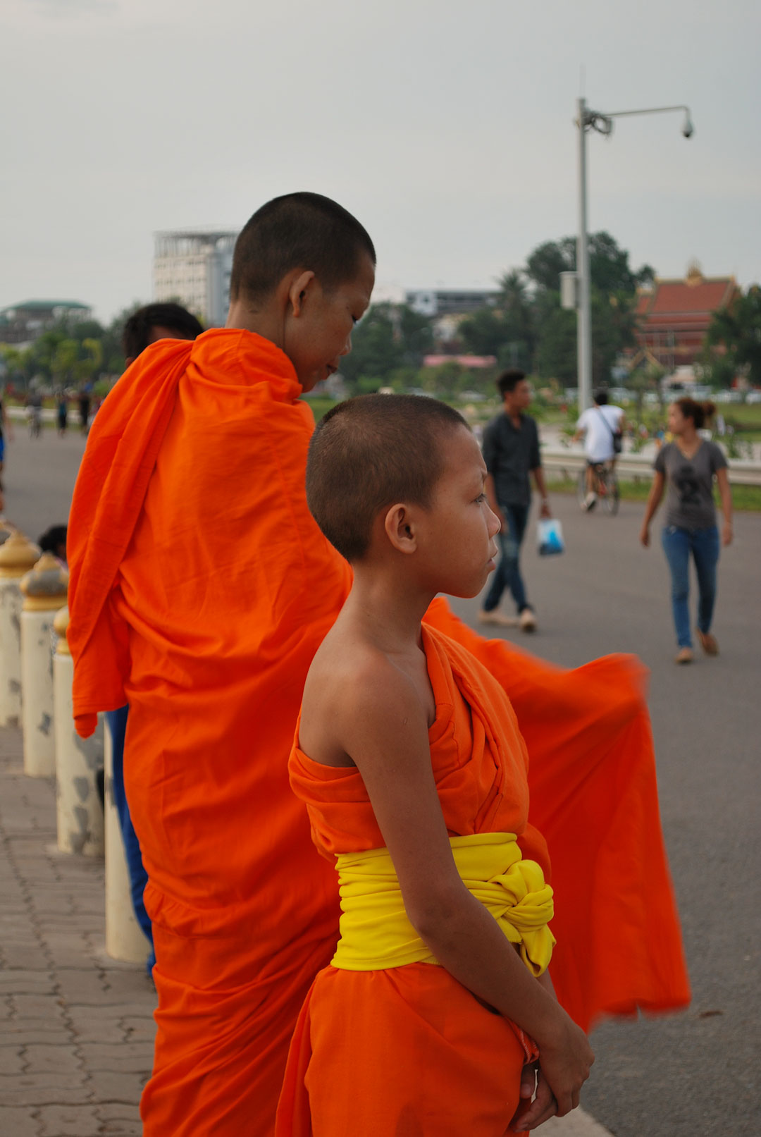 Monks near the Mekong