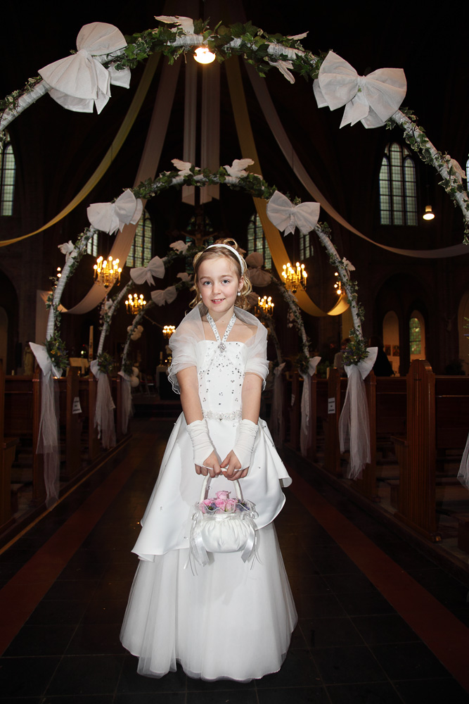 first communion girl in church aisle
