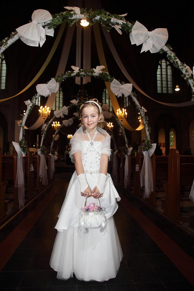 first communion girl in church aisle