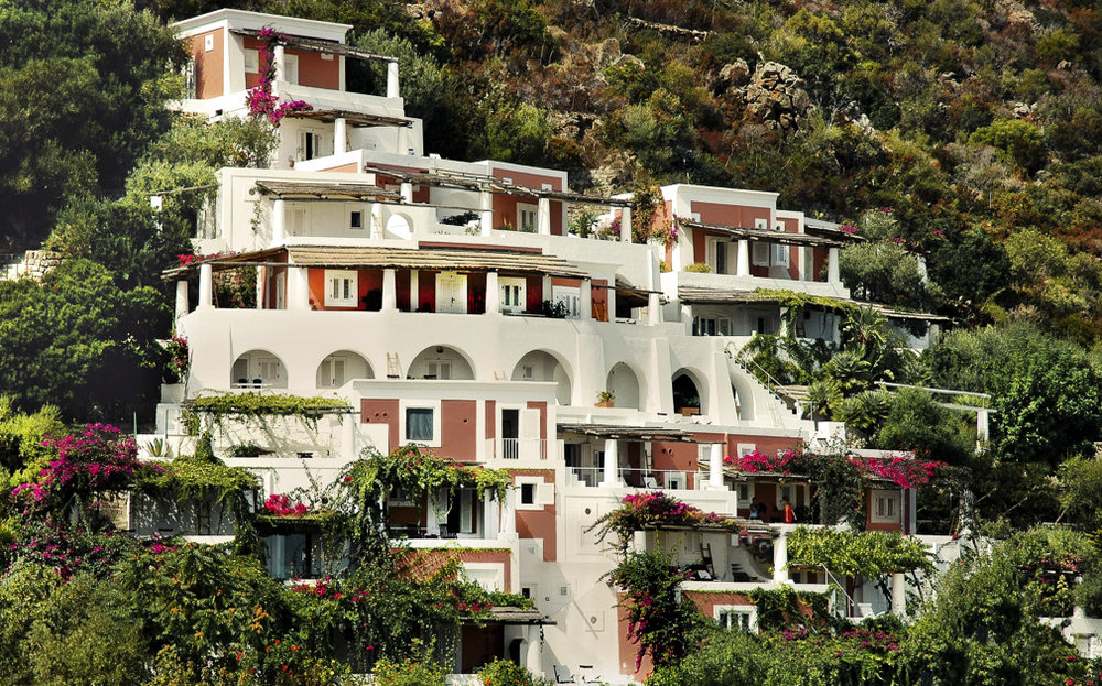 STAY | HOTEL RAYA > A CHARMING BOUTIQUE HOTEL BUILT ON A HILLSIDE IS A FIVE MINUTE WALK UP NARROW COBBLE WALKWAYS.