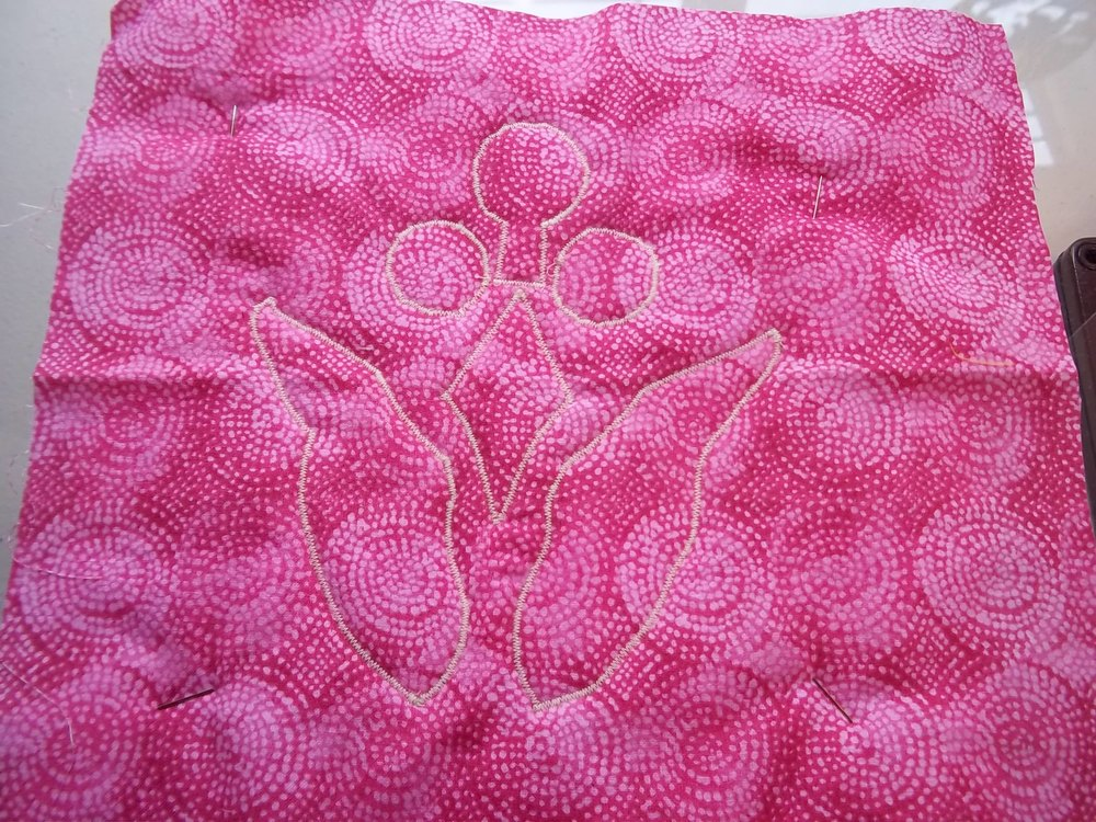 Machine appli-quilted from the back