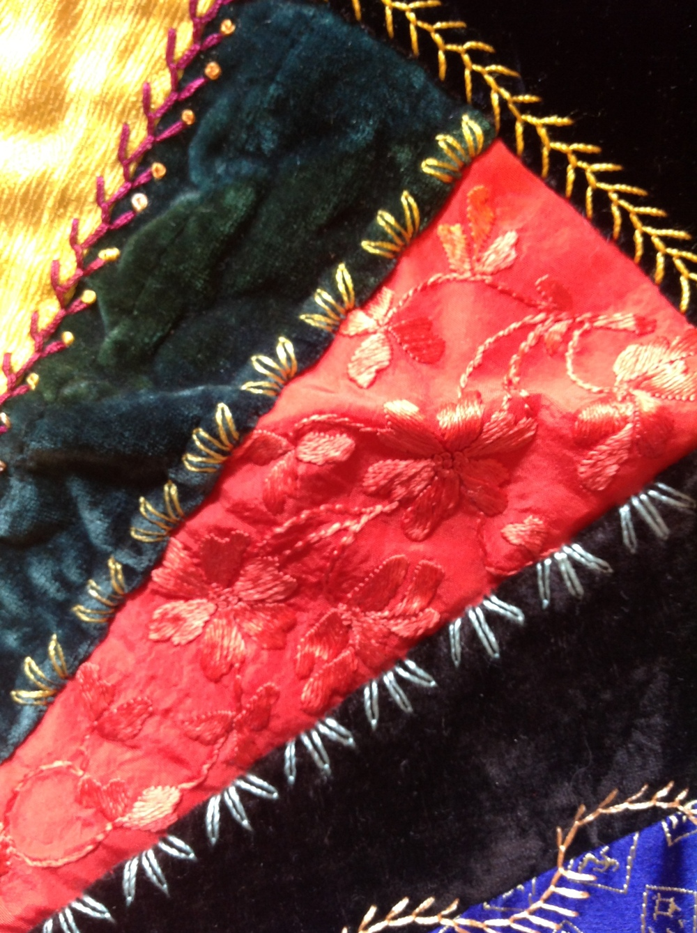 Fan quilt circa 1895. silk and velvet with silk embroidery.
