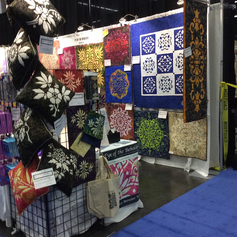 Eye of the Beholder quilts on display at Quilt! Knit! Stitch!, Portland, OR.
