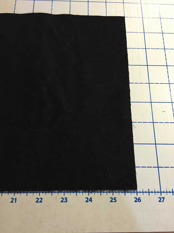 "Cut sleeve fabric width of piece(26"") by twice the sleeve depth (9"")."