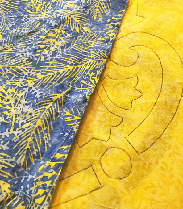 Tracing Hearts & Fleurs design onto Caribbean Splash fabrics by Island Batik.