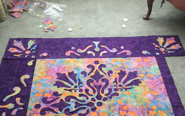 Playing with fabric and placement on my design floor.