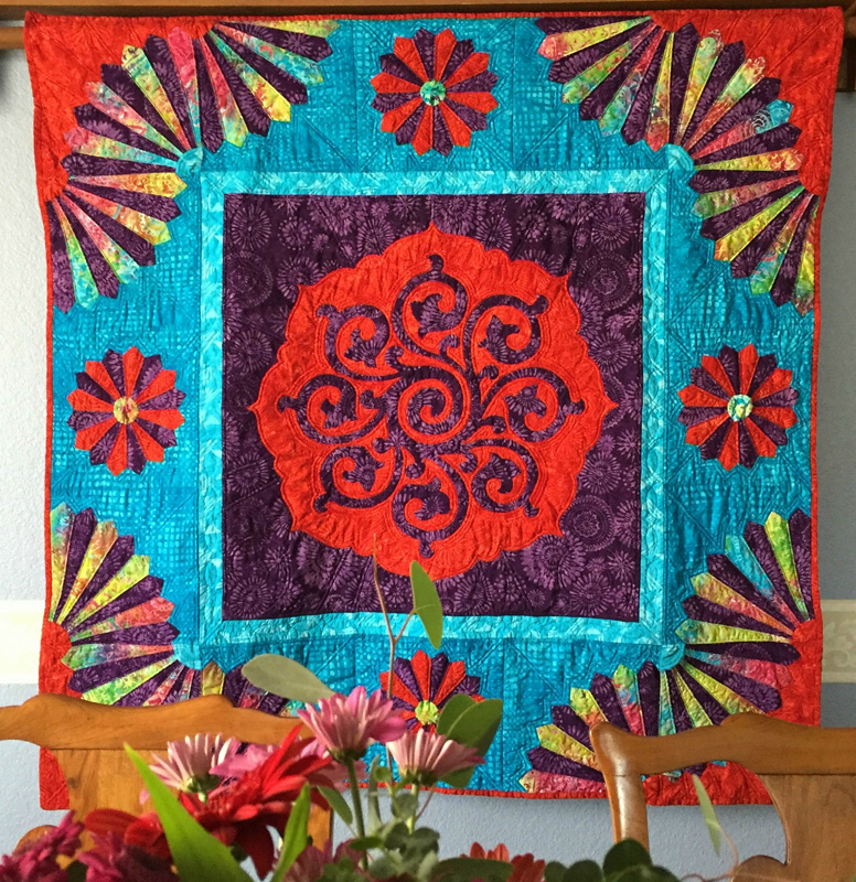 "Fan The Flame Quilt VIII (50"" x 50""). Hand reverse applique, machine pieced"