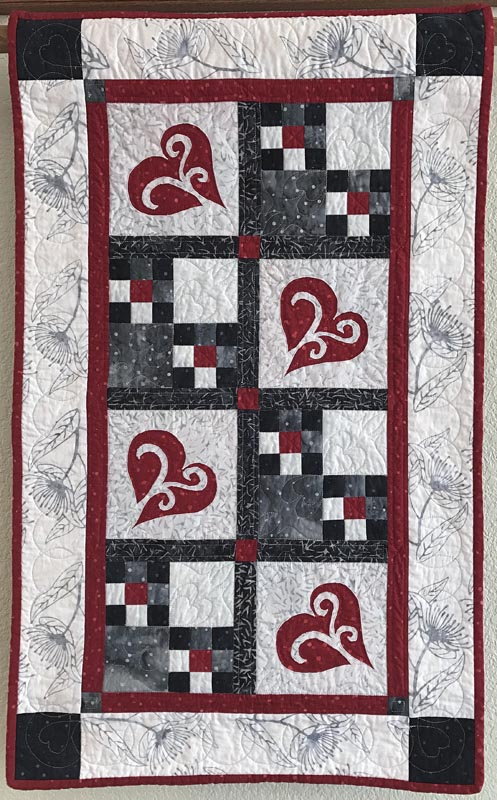 """Snowy Hearts table runner IX (21"""" x 35""""). hand or machine reverse applique and machine pieced. Designed for Island Batiks spring 2017."""