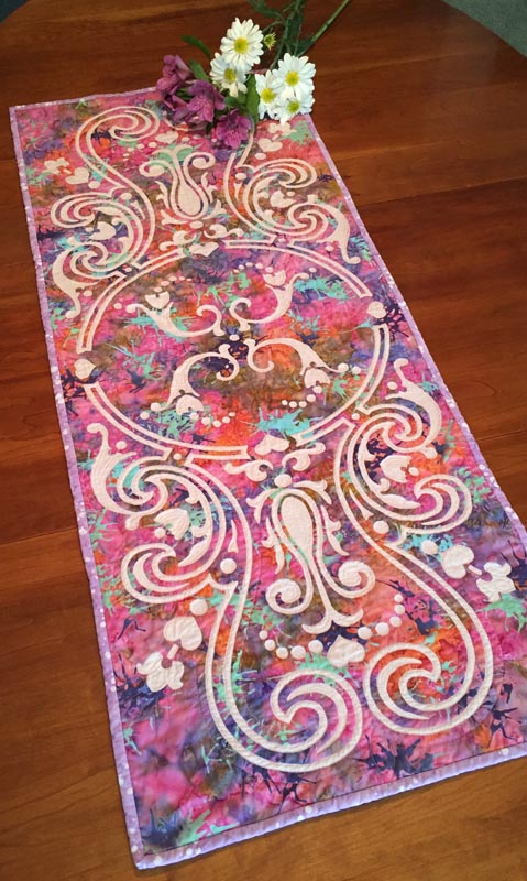 "Eternal Spring table runner VII (18"" x 43"") for hand reverse appplique. Designed in fabrics by RJR for Keepsake Quilting."