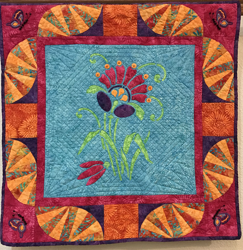 "Amidala's Flower mini-quilt    (28"" x 28""). hand or machine reverse applique with applique and machine pieced. Designed for Island Batiks Spring 2017 in the Empress Garden collection."