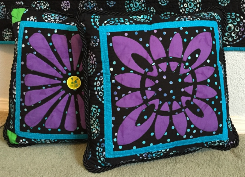 Blocks 13 and 6 from  Midnight Explosion Quilt VII  created as pillows. Created by machine reverse applique.