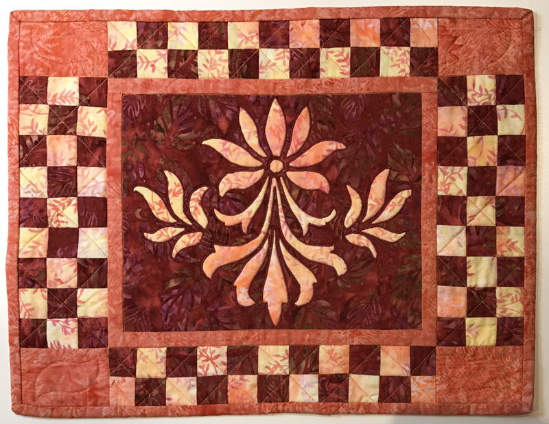 "Fleur de Lis block  (10"" x 12"") used here in the center of a small machine reverse appliqued quilt."