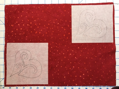 Position fusible squares on the wrong side of the place mat tops. For the red ones I placed them in the upper right and lower left corners.