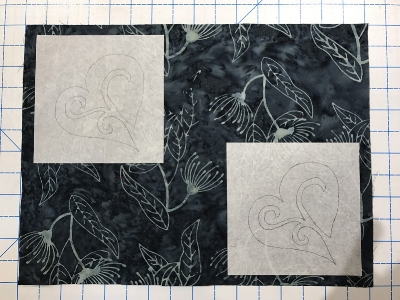 Position fusible squares on the wrong side of the place mat tops. For the black ones I placed them in the upper left and lower right corners.