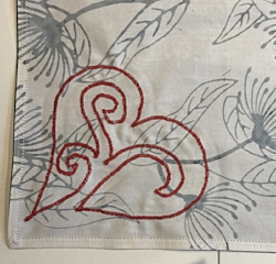 White side of napkins. Red reverse applique heart outline shows through to back of napkins.