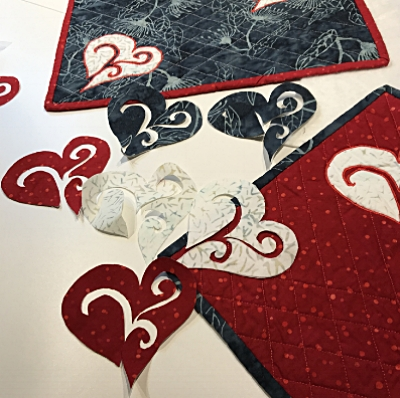 Cut them out carefully so you have the fused hearts to use for applique. Quite a pile of potential creative fun.