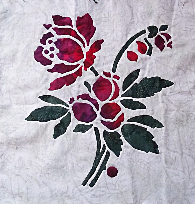 "Rose, 2/9 (16"" x 16"") with reverse applique greenery and appliqued blossoms."
