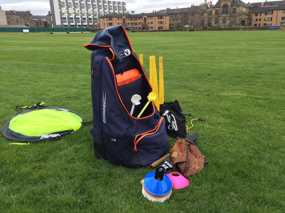 Setting up cricket fielding practice at West of Scotland CC..