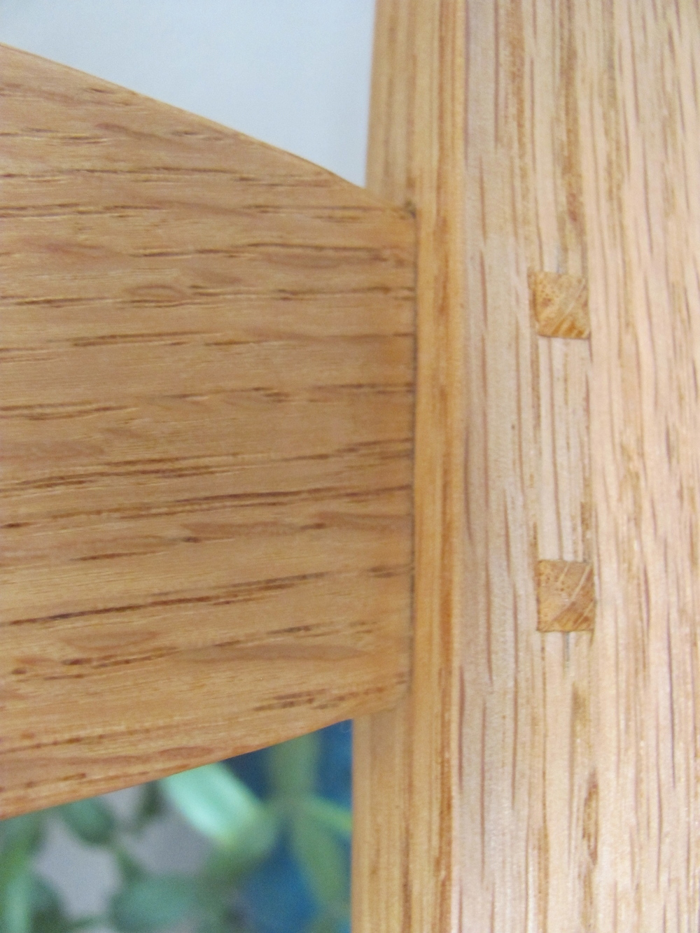 An extreme close-up of the workmanship. The slat tenons are hand fitted to very exacting tolerances (.2550 tenon into a .2500 mortise). They are 3/4 inch long and  pinned  with pyramid-shaped pins for decades of everyday use.
