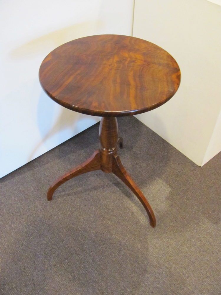 The Shaker pedestal table is my hands down favorite style of table. Its lines are fluid, almost seamless. Its form is simple, yet there is a timeless elegance in its urn-like base and arched, tapered legs. It's the quintessential American table.  Would you have guessed that the style is from the 1820s? Does it look out of place today? Would it look out of place in your home? Isn't it strange how certain forms seem hold their appeal, regardless of the times? Is that the power of art?     The Kentucky Shakers, it seems, were ahead of their New England brethren:  not only did they combine the usual function and form philosophy, they added  figure  by using cherry, walnut, and butternut (plus curly woods). My piece extends that concept even more: use the finest figure you can find—all still for the glory of God, of course.    Curly cherry, butternut, figured hard and soft maple—these are some of the woods I've used to make this style of pedestal table. They all have their unique attributes. It's really a subjective call to say which is best.    Recently included on that list is this curly claro walnut table with a book-matched top for my youngest daughter. California claro walnut differs from Mid-western black walnut in that it has more color variation in my opinion, especially orange highlights in the heartwood.    Let's just say that if you make a pedestal table for  one  daughter, you better make another for your  other  daughter, or….well you understand.