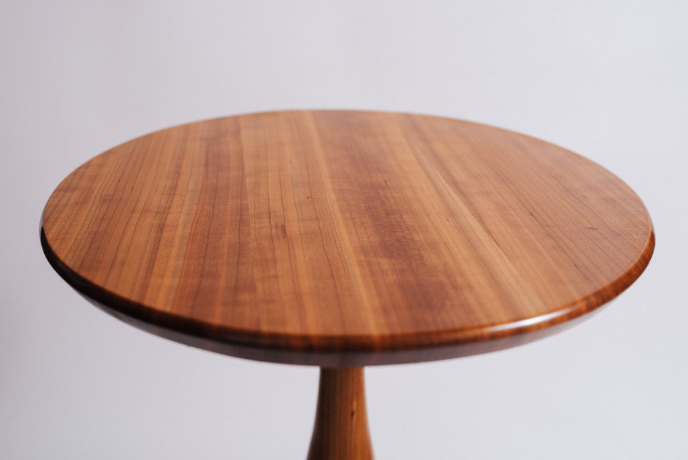 Quarter-sawn cherry pedestal table.