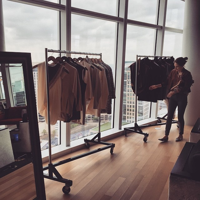 Designer Lee Anderson inspects the racks at Museum Tower in Dallas, TX.
