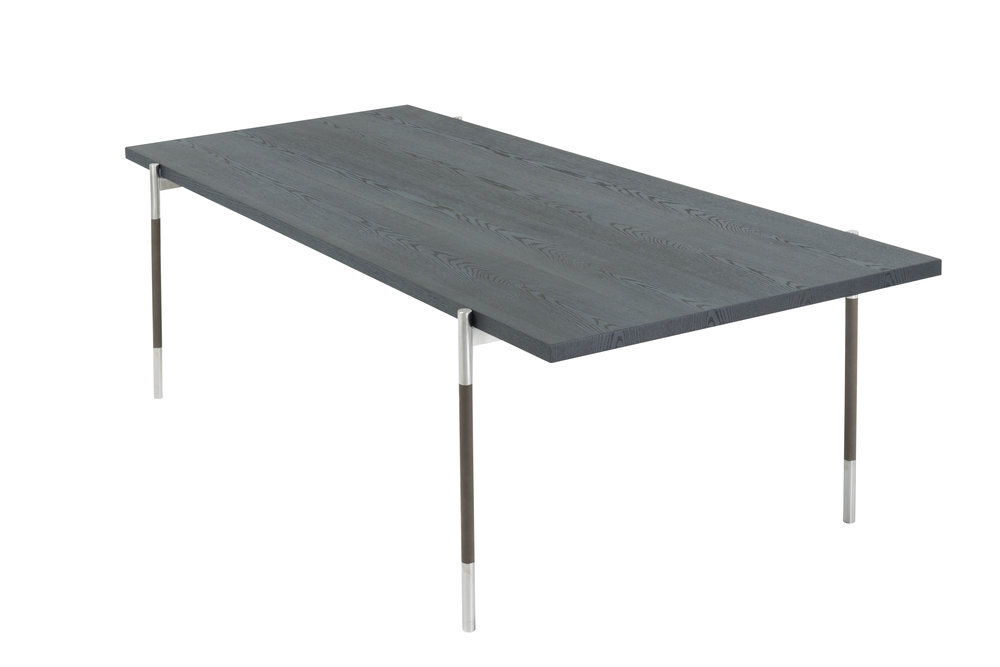 Table has leather wrapped steel legs, ebonized ash wood top. Many finishes available,  Made in Italy