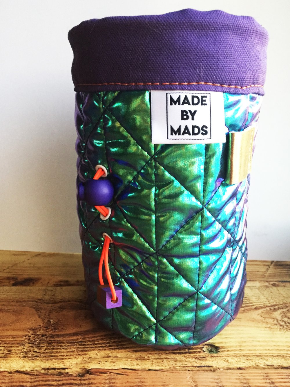 Bowie - Chalk Bag - The Bowie Chalk bag metallic quilting technique, will empower you with rad betta. She's got your back - included with a brush holder, a faux fur cheetah interior, as well as, a one hand synching system to allow you to keep one hand on the rock.$30.00Interested in buying? Contact Madison at madisondheim@gmail.com for inquiries!