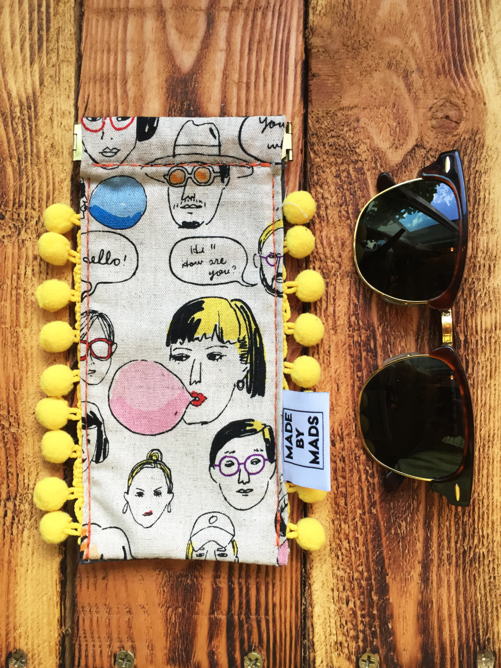 Bliss with Faces  - The Bliss with Faces Sunglass Case is the perfect accessory for the summer! She has a snap clutch which keeps the case sealed and makes it easy to open with one hand.$20.00Interested in buying? Contact Madison at madisondheim@gmail.com for inquiries!