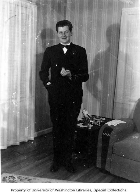 Nick Arthur standing in a suit, probably taken in Seattle, 1947