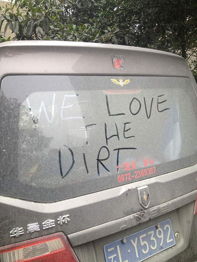 The van, once shiny in the recent past, now covered in dirt... and love...