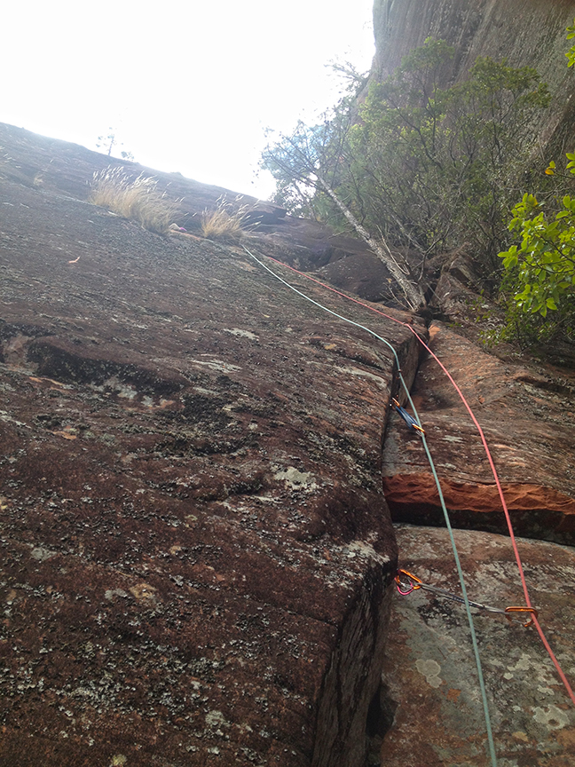 Looking up towards the belay on P6. The aid section is off to the right. This short pitch could go free if cleaner, but it will likely be 5.12.