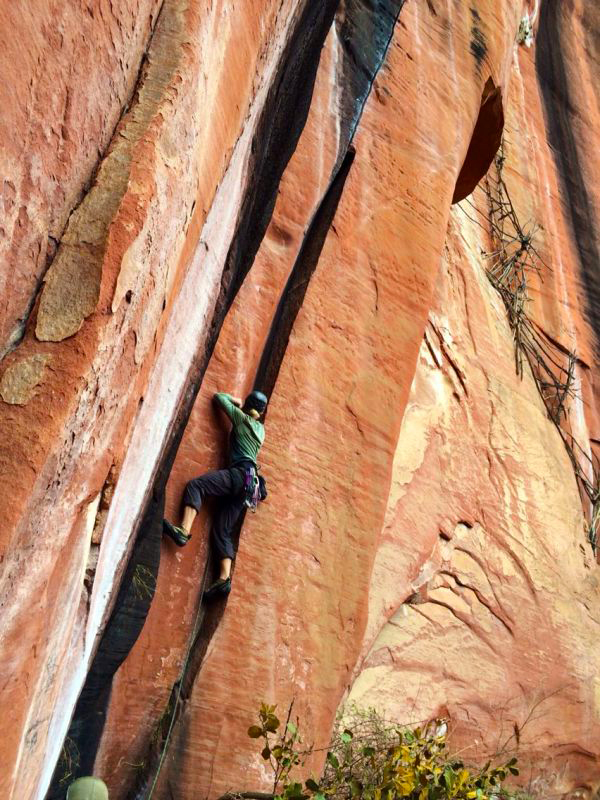 Dan Jerke starting up the offwidth on  Ding Dong's Crack .