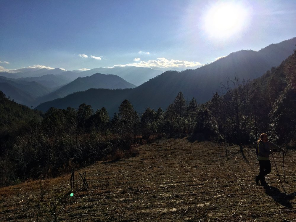 Out in the mountains of Yunnan: Dane enjoys some late day sun on the walk down from Baiyansi.