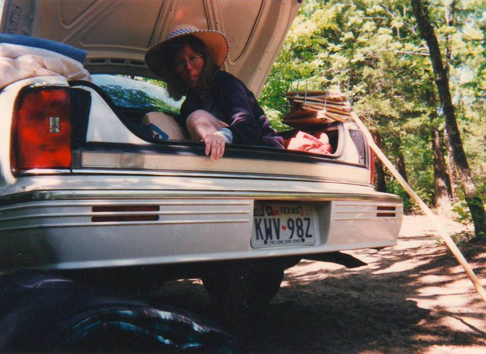 Probably my favorite picture: my silly mom rearranging the trunk after a camping trip. Note the flower presses on right side. Creative even while camping.