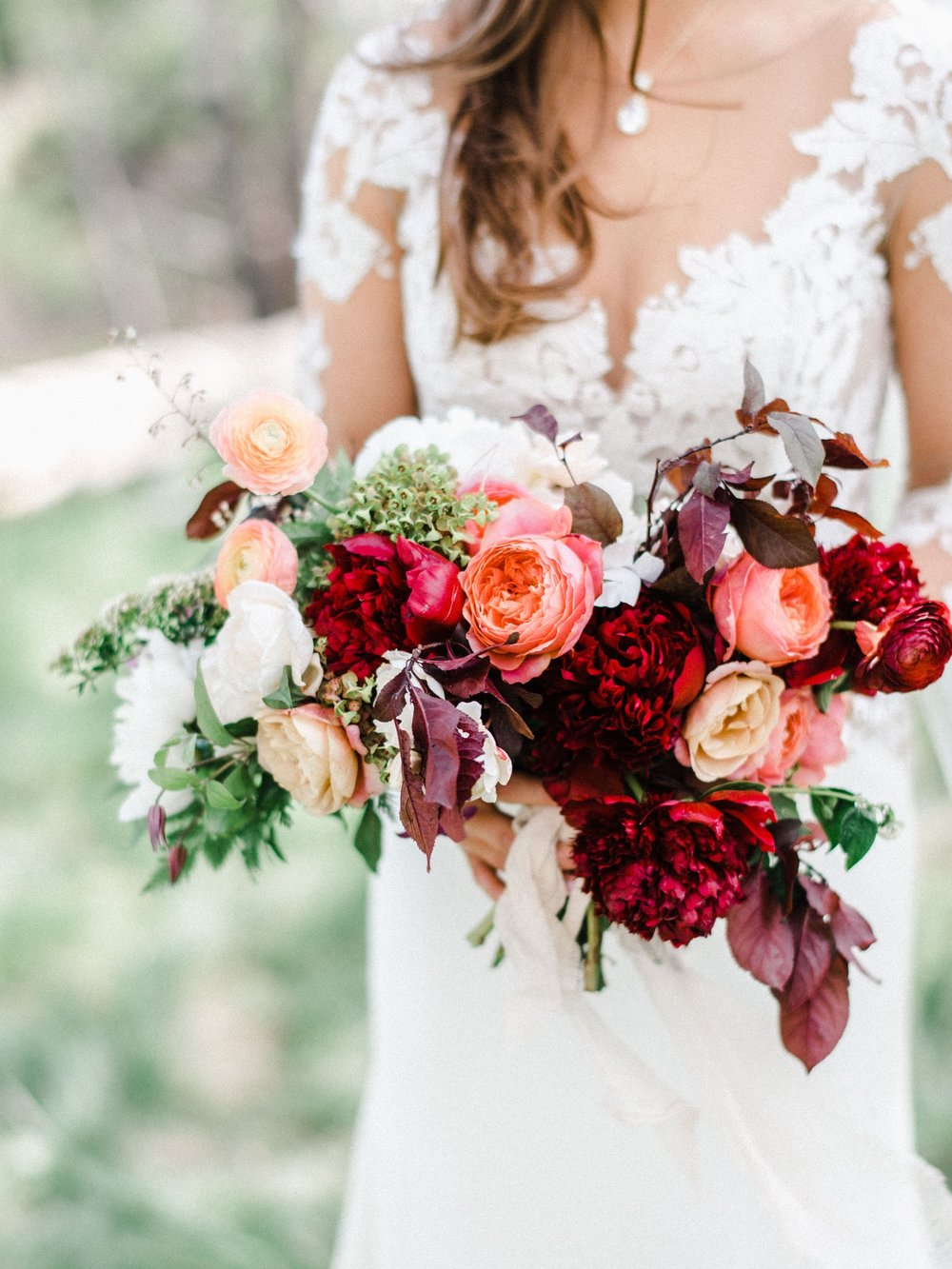 red peonies, burgundy foliage, salmon garden roses wedding bouquet