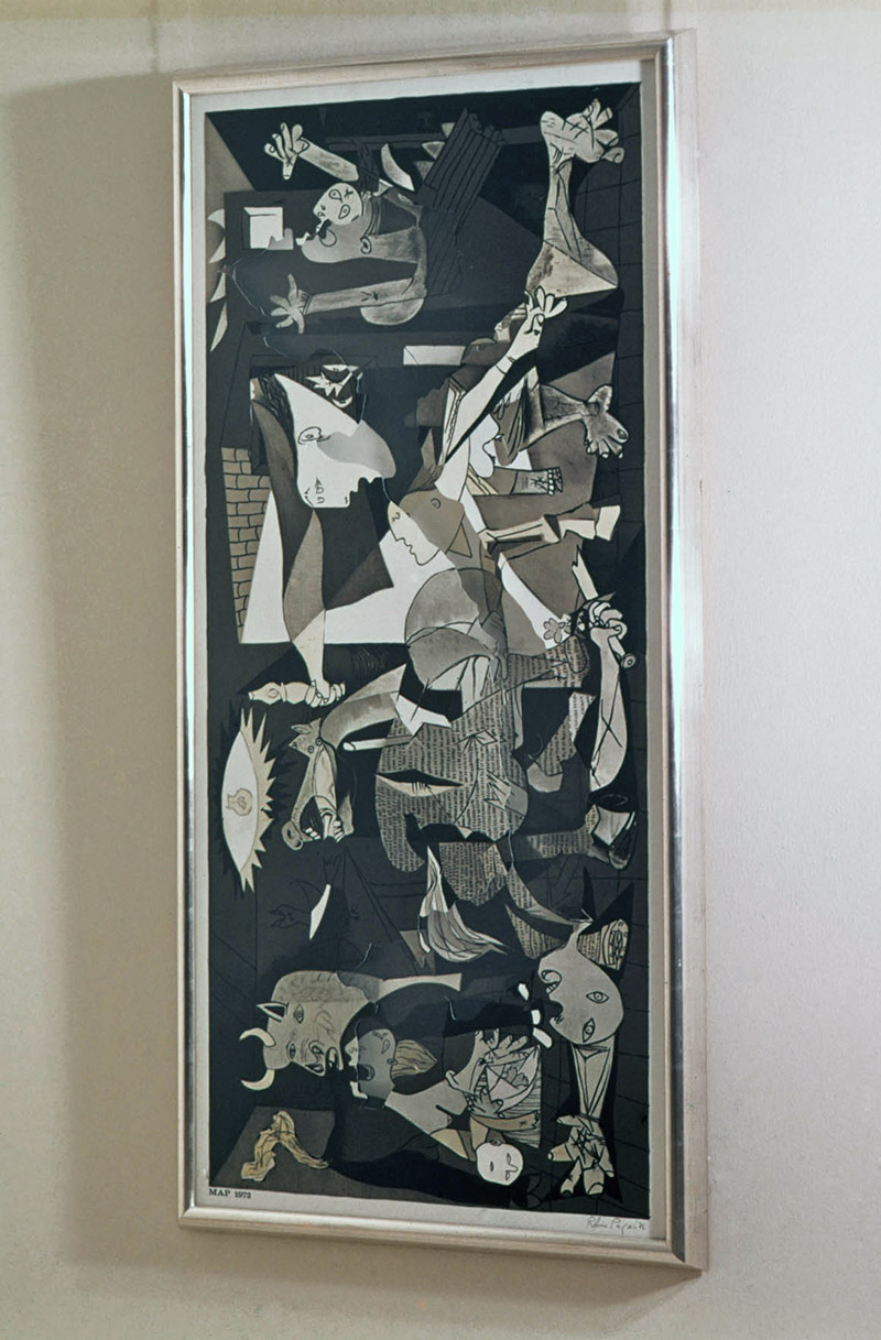 Repro of Guernica seen through a repro of Guernica cut in the shape of Vietnam