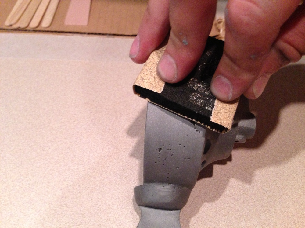 Block sanding the bare metal