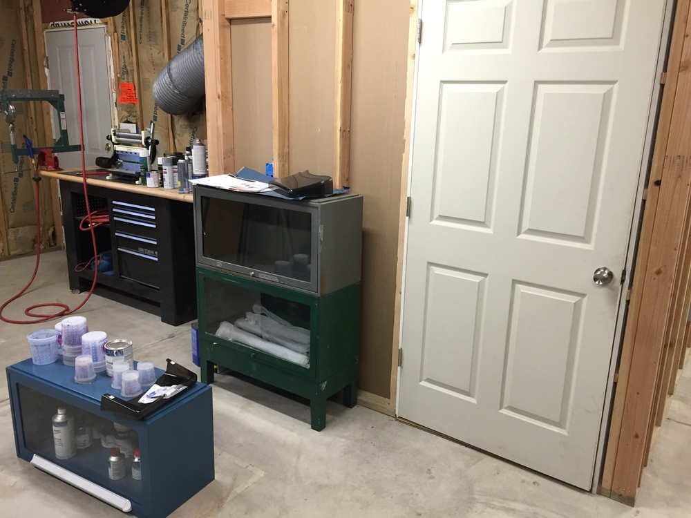 I'm refinishing the cabinets on the left. The one on the floor shows the final product. These cabinets were purchased on the side of the road and are wonderful. They will hold paint and solvents for the spray booth and will be stacked four-tall.
