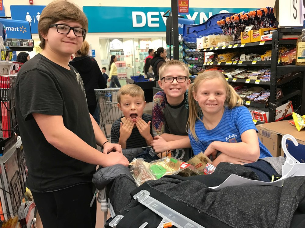 An amazing family building experience filling up shopping carts with clothing and supplies for the orphanage.