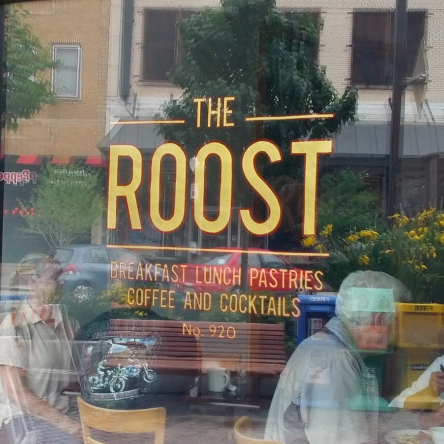 The Roost logo painted on the front window