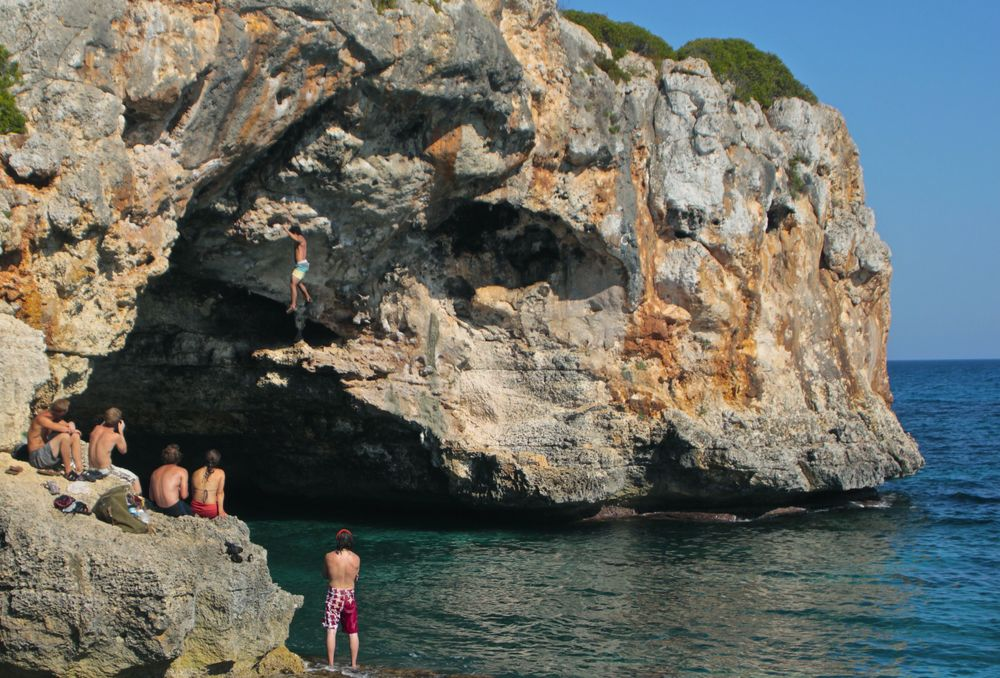 Deep water soloing at one of the most beautiful beaches I've ever seen