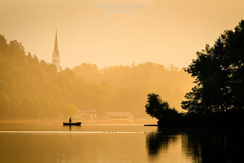A fisherman, in the early morning on Lake Bled