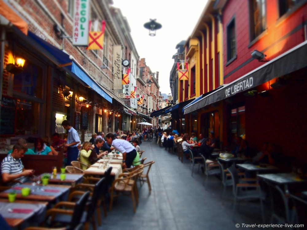 Munstraat in Leuven is a popular street among university students and tourists, because of its many restaurants, pubs, and bars.